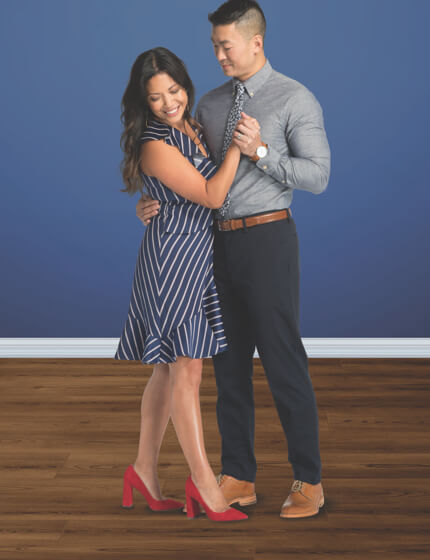 Couple dancing on Luxury Vinyl flooring | Boyer's Floor Covering