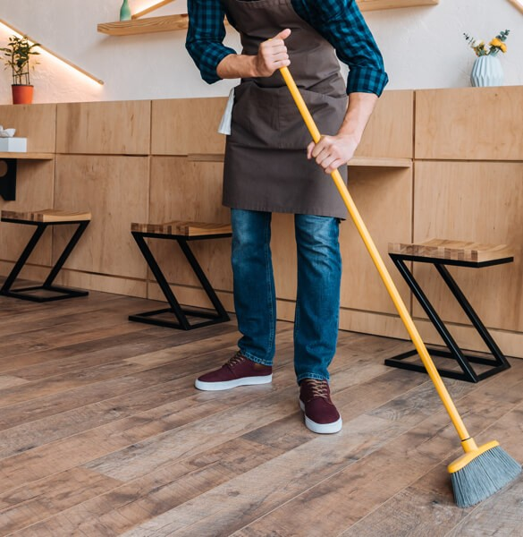 Sweeping hardwod floor | Boyer's Floor Covering