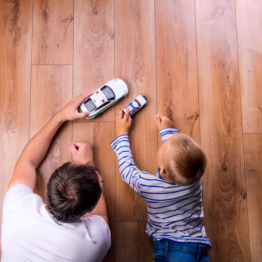 Father with kid playing with toycar | Boyer's Floor Covering